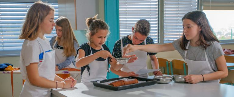 Kids cooking together in class environment